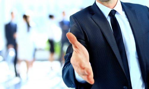 26278436 - businessman offering a handshake